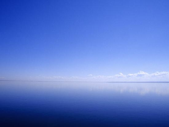 jason-edwards-blue-sky-and-clouds-reflected-in-a-perfectly-still-coastal-lake