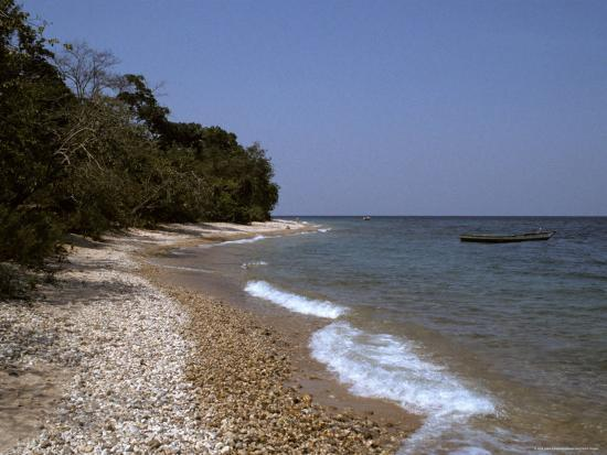 jason-edwards-fisherman-s-boat-rests-by-the-pebbled-shore-of-lake-tanganyika