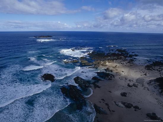 jason-edwards-waves-smashing-onto-a-rugged-remote-coastline-beneath-storm-clouds-australia
