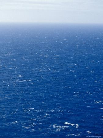 jason-edwards-wind-creates-white-capped-waves-sprinkled-across-a-vast-blue-ocean-bass-strait-australia