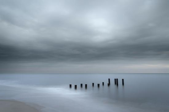 jaynes-gallery-usa-new-jersey-cape-may-national-seashore-beach-pilings-on-stormy-sunrise