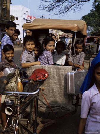 jenny-pate-schoolchildren-in-cycle-rickshaw-aleppey-kerala-state-india