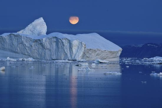 jensen-full-moon-over-an-iceberg-at-dusk-saqqaq-disko-bay-greenland-september-2009