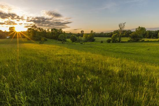 jerry-and-marcy-monkman-last-light-in-a-hay-field-in-epping-new-hampshire