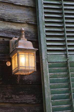 joanne-wells-usa-florida-st-augustine-shutter-and-lantern-on-old-house