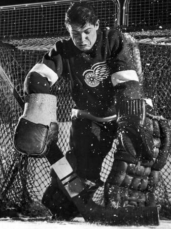 joe-scherschel-terry-sawchuck-star-goalie-for-the-detroit-red-wings-warding-off-shot-on-goal-at-ice-arena