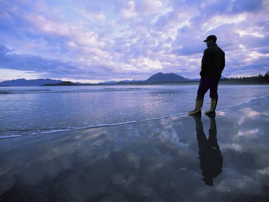 joel-sartore-a-man-stands-at-the-tide-line-on-vargas-island-at-dawn