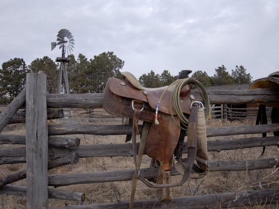 joel-sartore-a-saddle-is-left-behind-by-some-ranchers-in-the-nebraska-sandhills