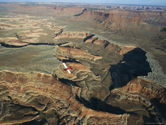 joel-sartore-a-small-aircraft-hovers-above-above-canyonlands-national-park