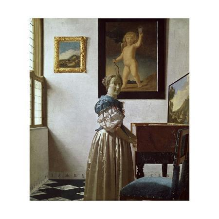 johannes-vermeer-a-young-woman-standing-at-a-virginal-c-1670