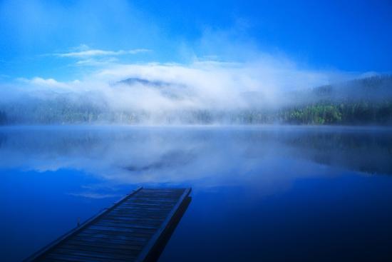 john-alves-an-empty-dock-on-a-calm-misty-lake
