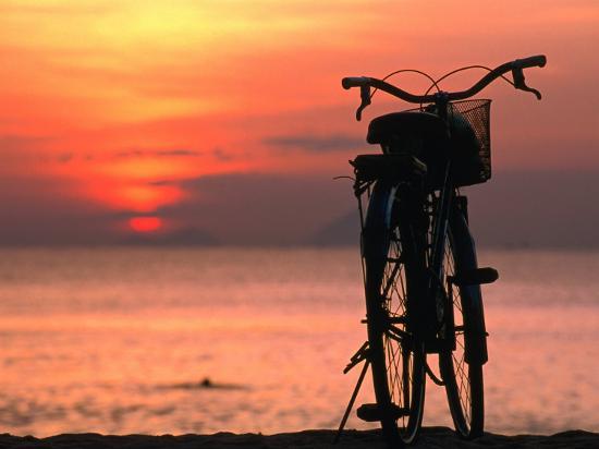 john-banagan-bicycle-silhouetted-against-sunset-on-nha-trang-beach-nha-trang-khanh-hoa-vietnam