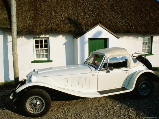 john-banagan-mg-sports-car-outside-thatched-cottage-tipperary-munster-ireland