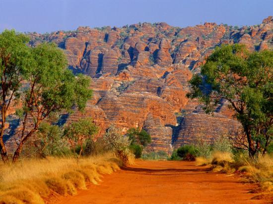 john-banagan-natural-rock-formations-of-bungle-bungles-and-dirt-road-leading-to-it-purnululu-np-australia