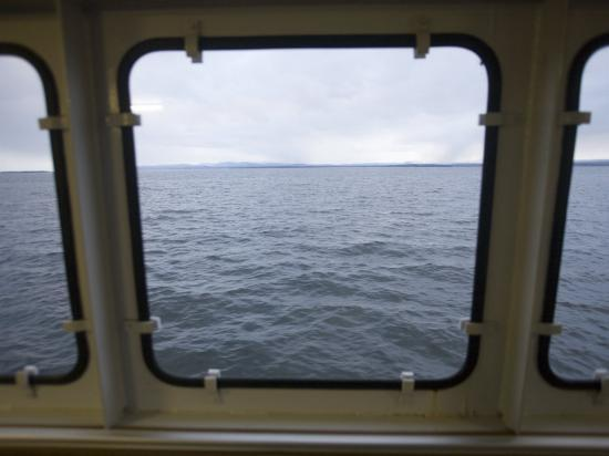 john-burcham-looking-out-a-ferry-boat-window-on-lake-champlain