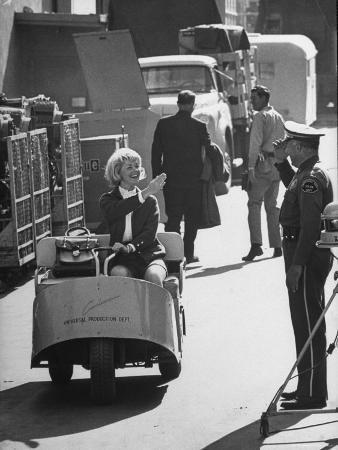 john-dominis-actress-and-singer-doris-day-driving-universal-production-department-golf-cart