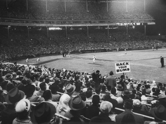 john-dominis-crowd-of-people-holding-up-signs-and-watching-dodger-cubs-game-from-stands-at-wrigley-field