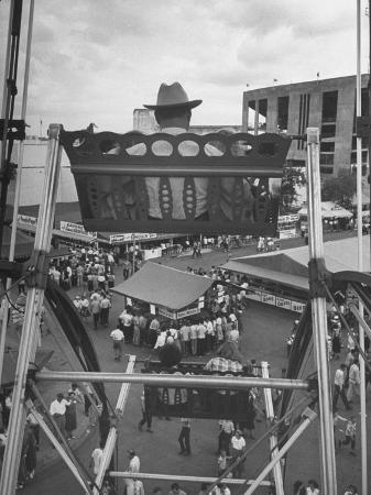 john-dominis-texas-rancher-with-kids-perched-92-ft-high-on-ferris-wheel-carnival-midway-at-county-fair