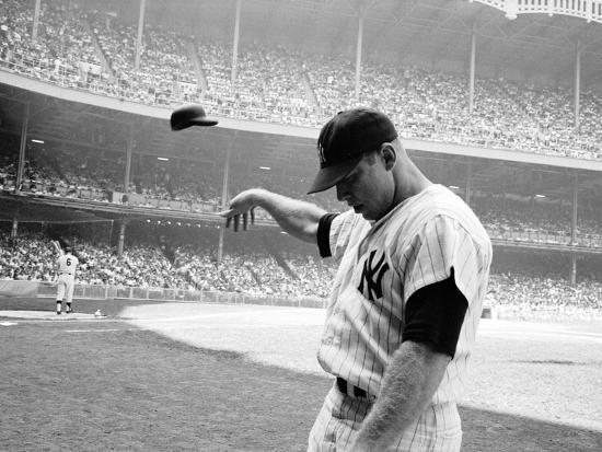 john-dominis-yankee-mickey-mantle-flinging-his-batting-helmet-away-in-disgust-during-bad-day-at-bat