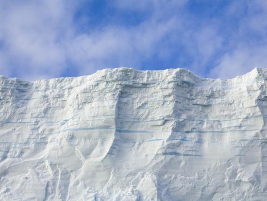 john-eastcott-yva-momatiuk-blue-tabular-iceberg-sculpted-by-waves