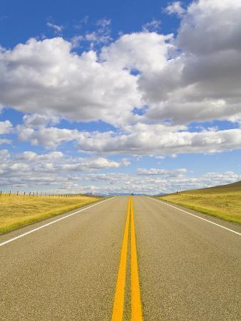 john-eastcott-yva-momatiuk-yellow-lines-freshly-painted-on-rural-highway