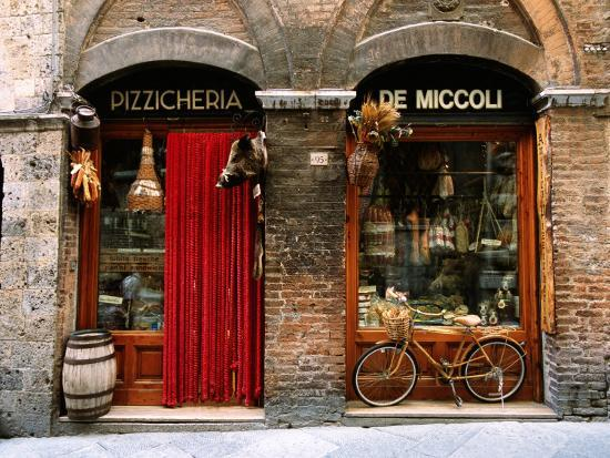 john-elk-iii-bicycle-parked-outside-historic-food-store-siena-tuscany-italy