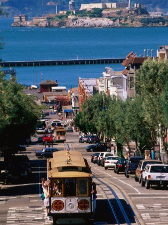 john-elk-iii-cable-car-and-other-traffic-on-street-with-alcatraz-in-distance-san-francisco-usa