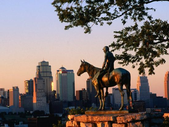 john-elk-iii-city-skyline-seen-from-penn-valley-park-with-indian-statue-in-foreground-kansas-city-missouri