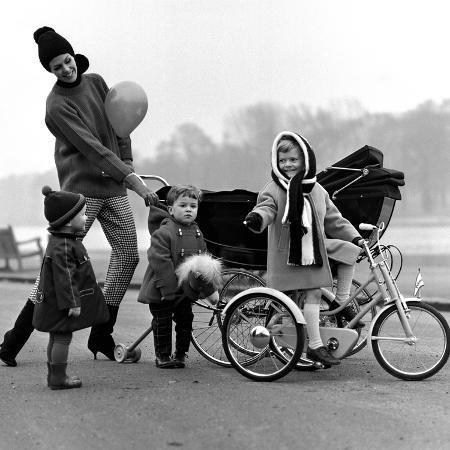 john-french-jenny-boyd-in-light-pants-and-boots-with-children-1960s