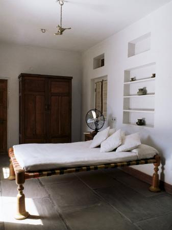 john-henry-claude-wilson-bedroom-with-traditional-low-slung-bed-or-charpoy-in-a-home-in-amber-near-jaipur-india