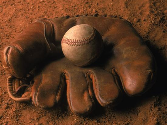 john-t-wong-baseball-glove-with-ball-on-dirt
