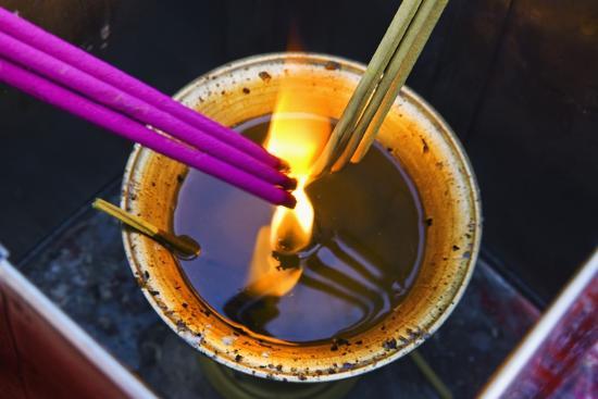 jon-hicks-lighting-incense-sticks-at-the-lama-temple