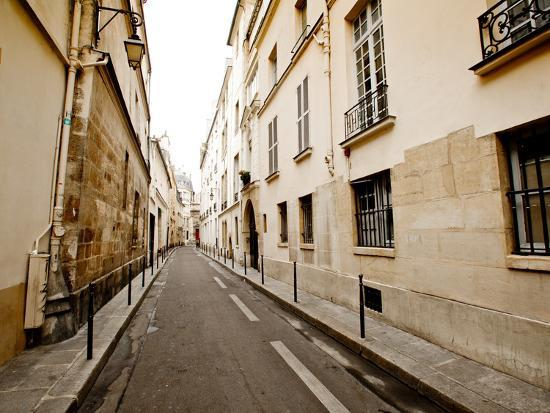 jorge-fajl-a-small-street-lined-with-traditional-parisian-buildings
