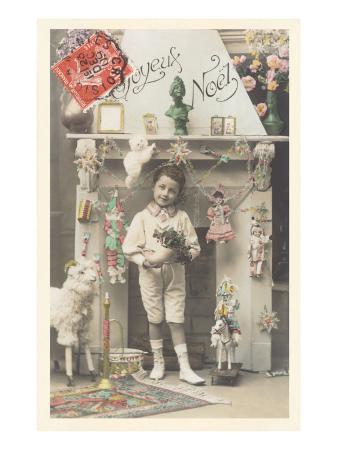 joyeux-noel-child-by-fireplace