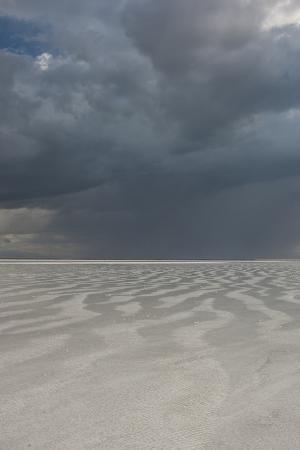 judith-zimmerman-utah-passing-thunderstorm-over-bonneville-salt-flats-leaving-flooded-desert-floor