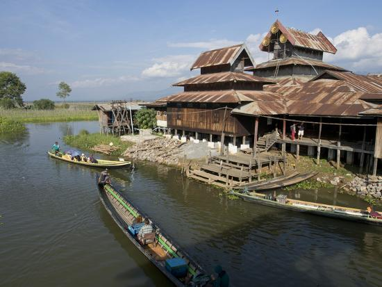 julio-etchart-tourists-arrive-by-boat-at-monastery-on-inle-lake-shan-state-myanmar-burma