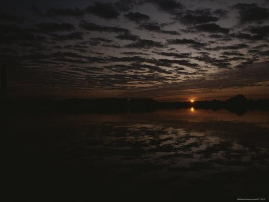 karen-kasmauski-a-dramatic-twilight-view-of-a-cloudy-sky-and-water-with-reflections