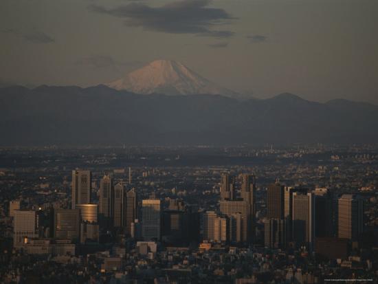 karen-kasmauski-mt-fuji-looms-in-the-distance-over-tokyo-s-skycrapers