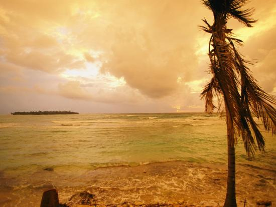 kate-thompson-a-tropical-beach-scene-with-an-island-in-the-background