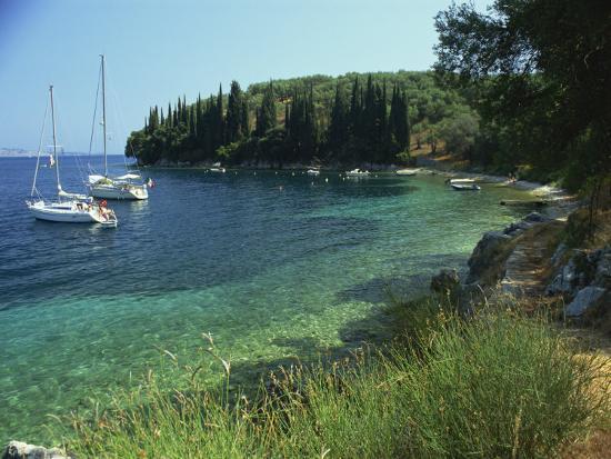 kathy-collins-yachts-moored-offshore-in-kalami-bay-on-the-coast-corfu-ionian-islands-greek-islands-greece