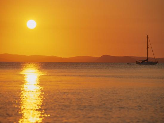 ken-gillham-view-to-mainland-from-monkey-beach-at-sunset-great-keppel-island-queensland-australia