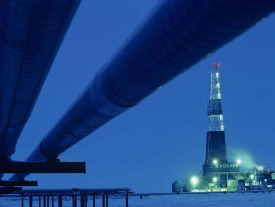 kenneth-garrett-alaska-oil-pipeline-and-oil-rig-at-night