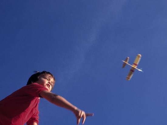 kevin-leigh-boy-flying-toy-airplane