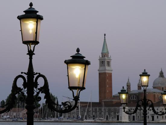 lampposts-lit-up-at-dusk-with-building-in-the-background-san-giorgio-maggiore-venice-italy