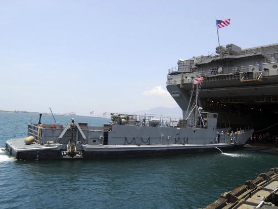 landing-craft-utility-near-amphibious-assault-ship-uss-essex-in-subic-bay-philippines