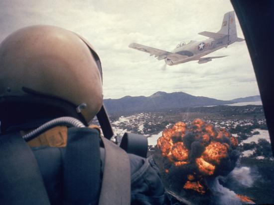 larry-burrows-american-jets-dropping-napalm-on-viet-cong-positions-early-in-the-vietnam-conflict