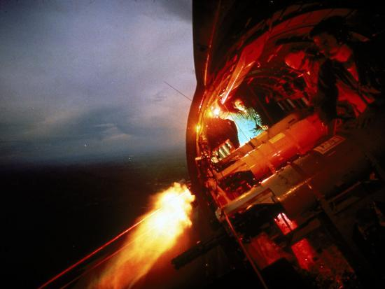 larry-burrows-crew-of-us-ac-47-plane-firing-7-62-mm-ge-miniguns-during-night-mission-in-vietnam