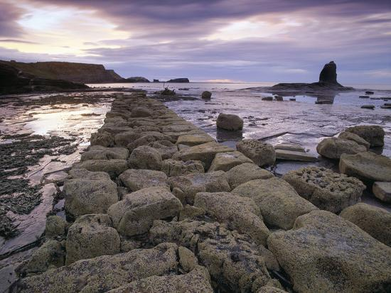 latitudestock-saltwick-bay-is-south-of-whitby-and-the-distinctively-shaped-black-nab-rock