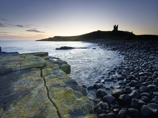lee-frost-across-rumble-churn-at-dawn-towards-ruins-of-dunstanburgh-castle-northumberland-england