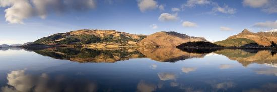 lee-frost-panoramic-view-of-loch-levan-in-calm-conditions-with-reflections-of-distant-mountains-scotland